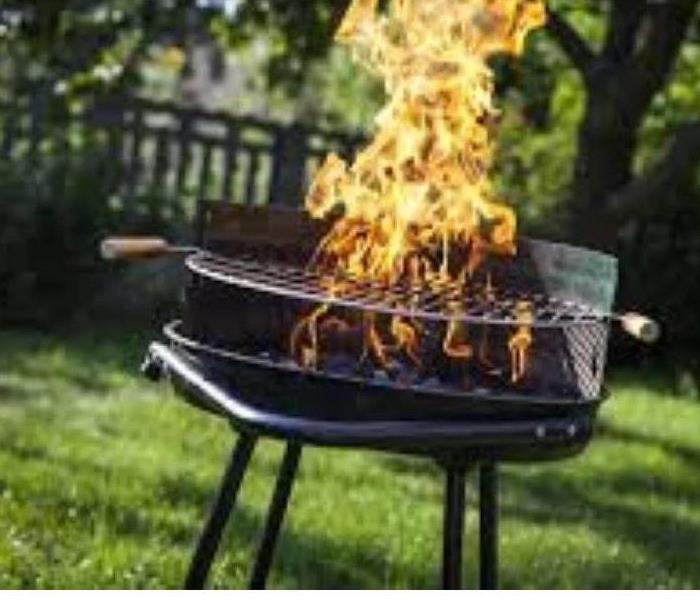 Grill with large fire