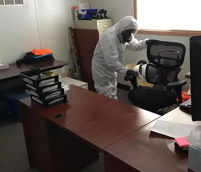 SERVPRO employee in PPE cleaning